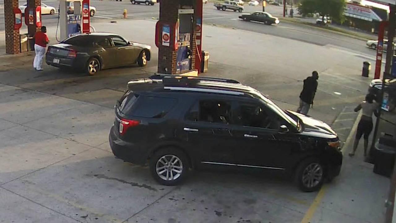 Man shoots woman trying to take his gun Detroit gas station outside