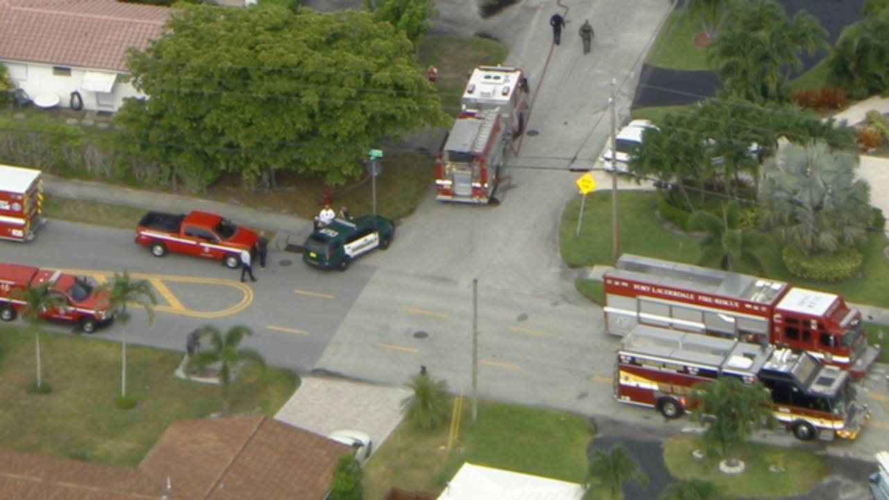 Firetrucks in front of Fort laud home