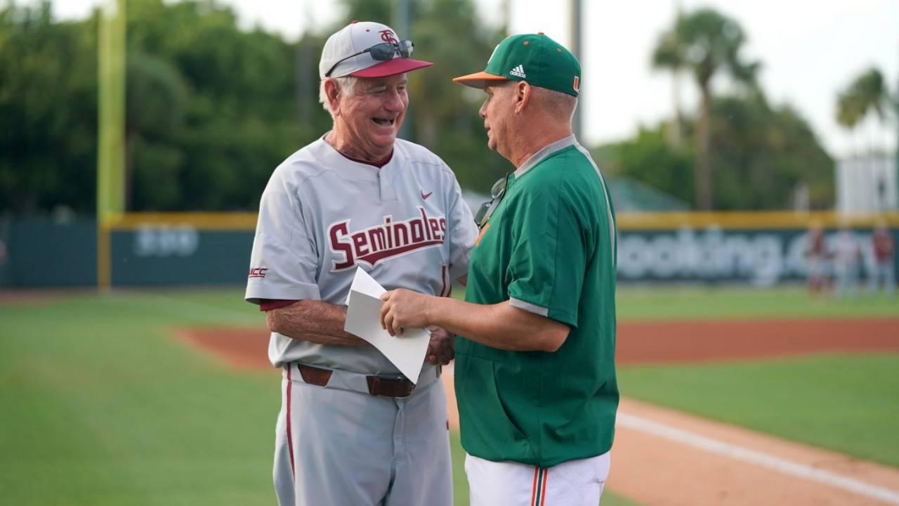 Florida State Seminoles baseball coach Mike Martin and Miami Hurricanes baseball coach Gino DiMare shake hands before series opener, April 5, 2019