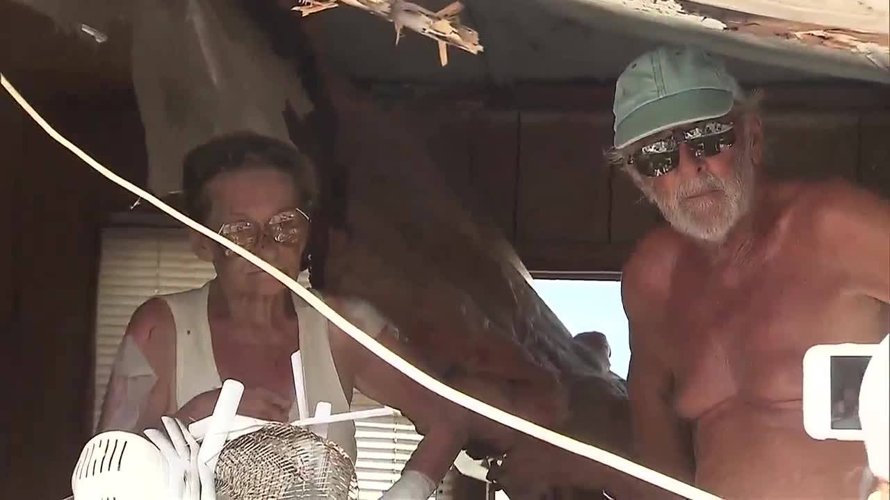 Jerry and Joy in crushed mobile home after Hurricane Irma