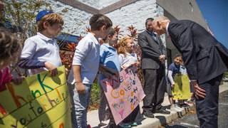 Scott signs scrutinized-companies bill at Orlando Jewish school