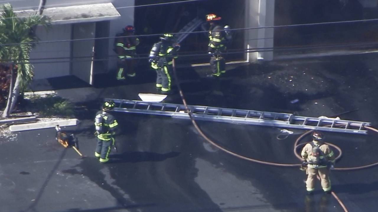 Firefighters at auto shop in Pompano Beach