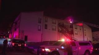 Firefighters battle blaze inside North Side apartment complex