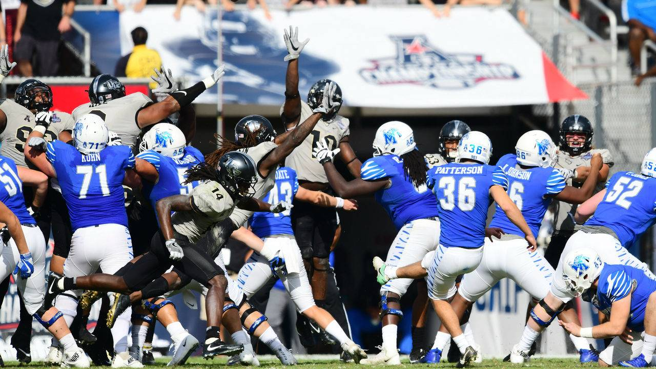 Memphis vs. UCF in the 2017 American Athletic Conference Championship Game  (Julio Aguilar Getty Images) 1d237d39d