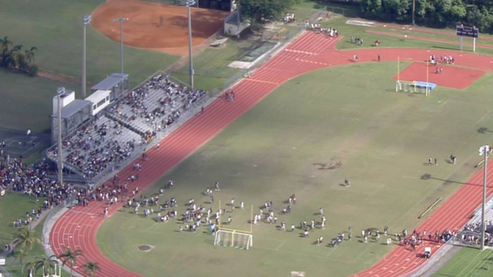 Students on football field at Western High School