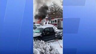 Driver pulled to safety after plow truck fire