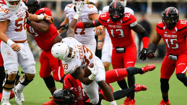 DOnta Foreman 33 Of The Texas Longhorns Is Brought Down By JahShawn Johnson 7 Tech Red Raiders During Game On November 5
