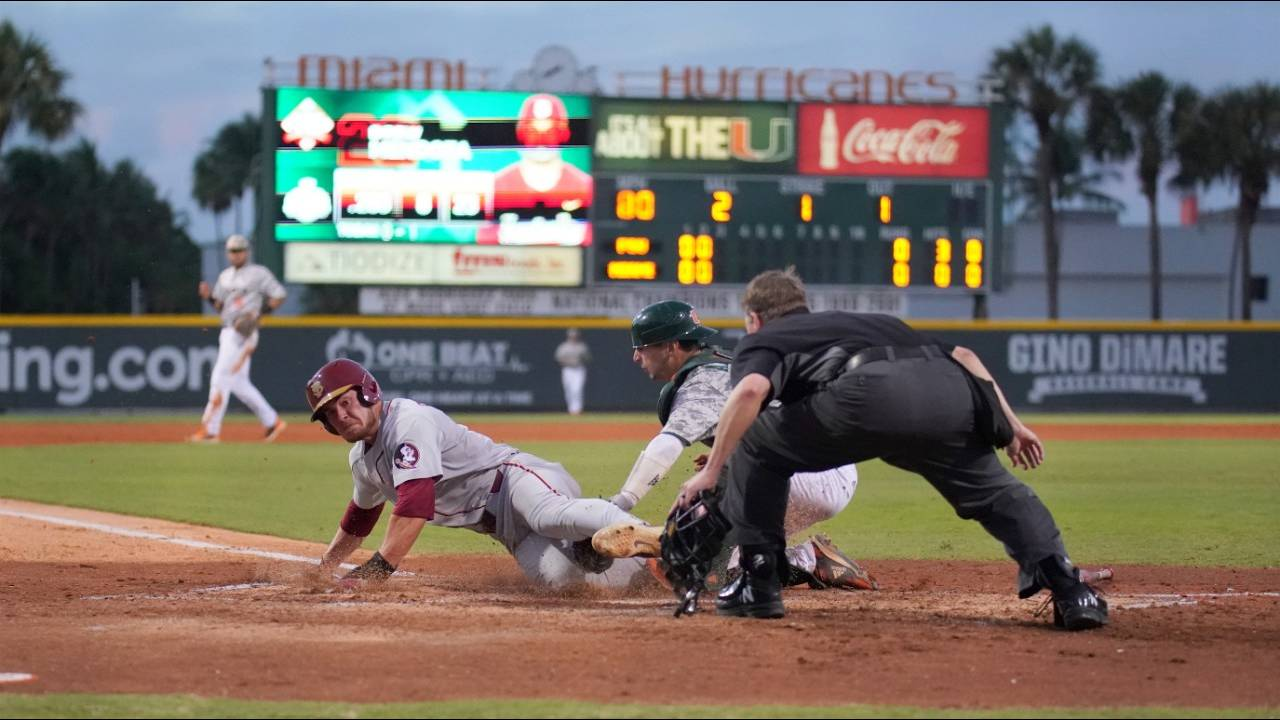Miami Hurricanes catcher Michael Amditis tags out Florida State Seminoles Cooper Swanson