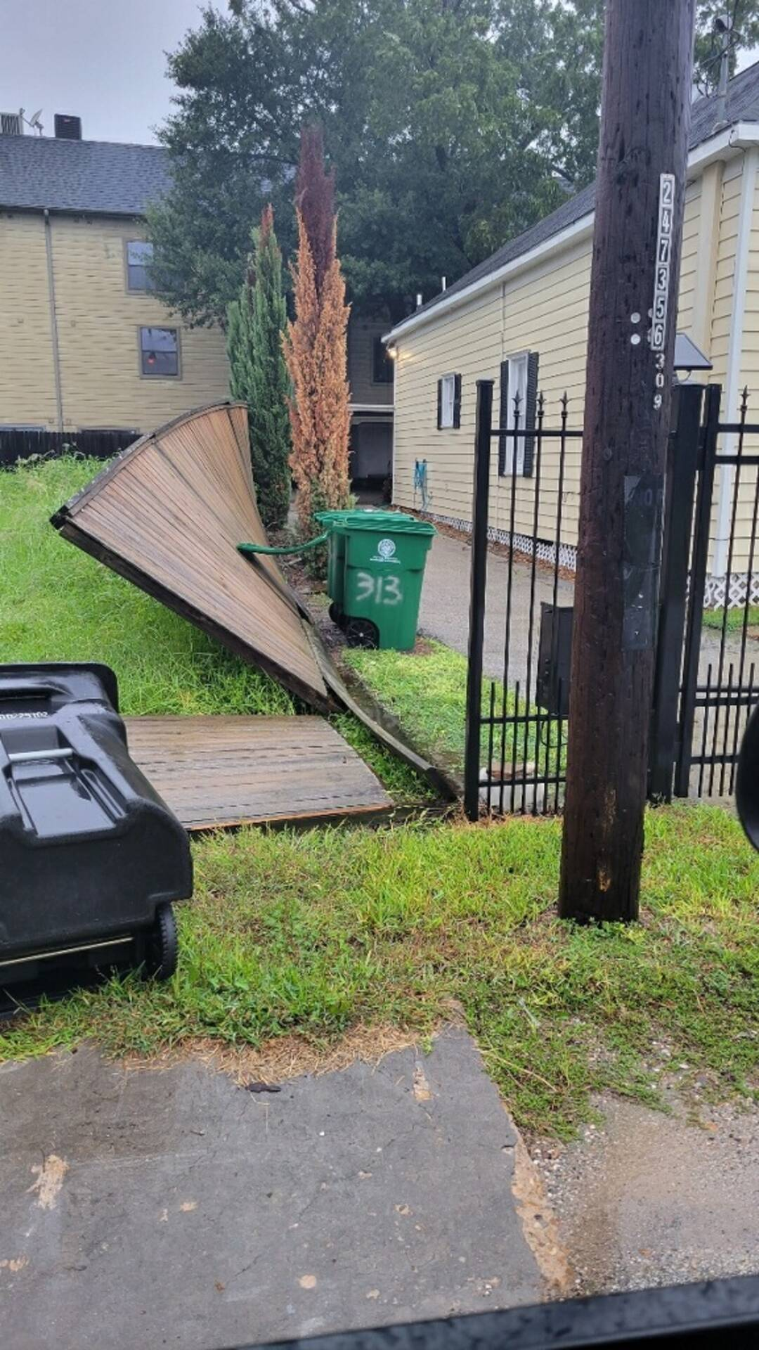 Either Nicholas got our fence or that green bin finally got tired of the fence talking back. LOL!