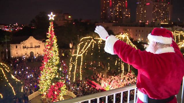 Group Hosting Christmas Event In Front Of Alamo After Tree