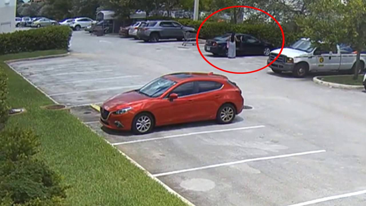 Woman locking child inside car at Fort Lauderdale BJ's Wholesale