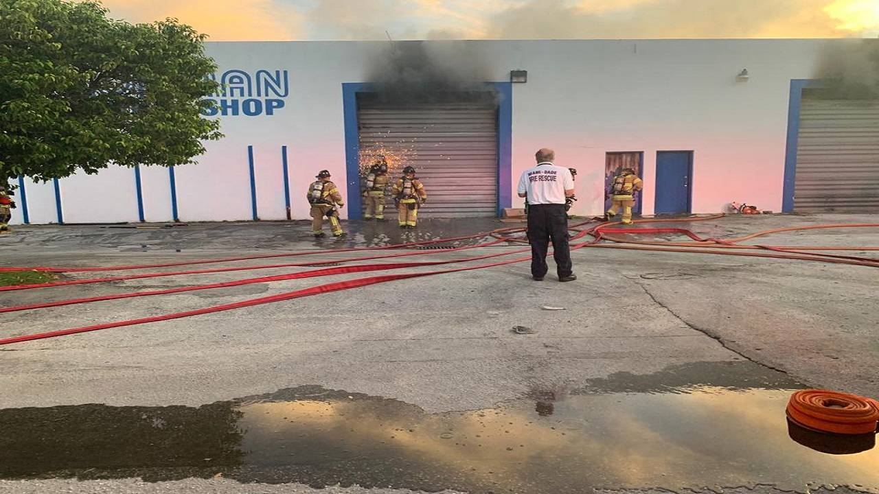 Firefighters breaking into warehouse
