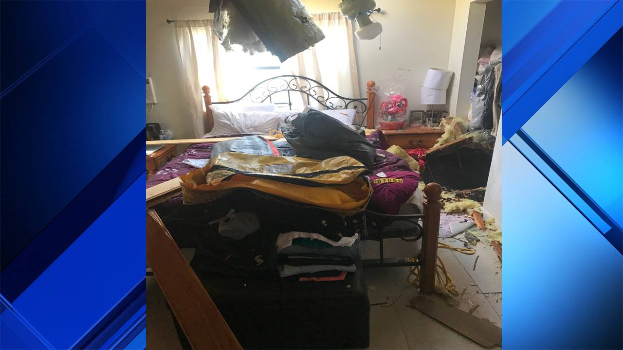 Inside bedroom after something crashes through roof