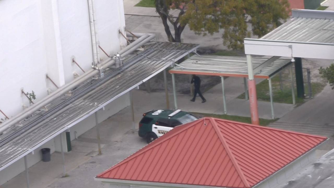 BSO SUV outside blanche ely high school