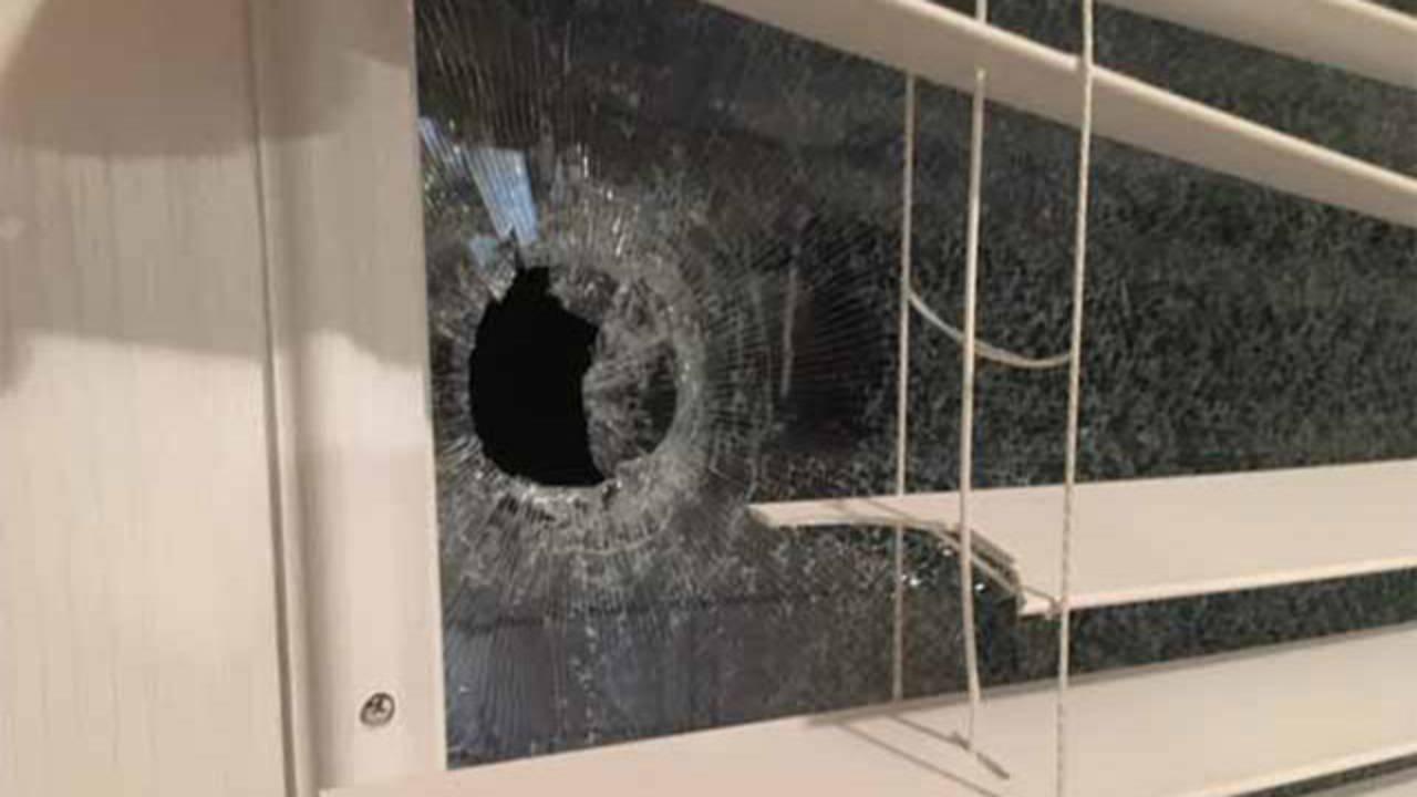 Bullet-hole-in-window_1547854493186.jpg