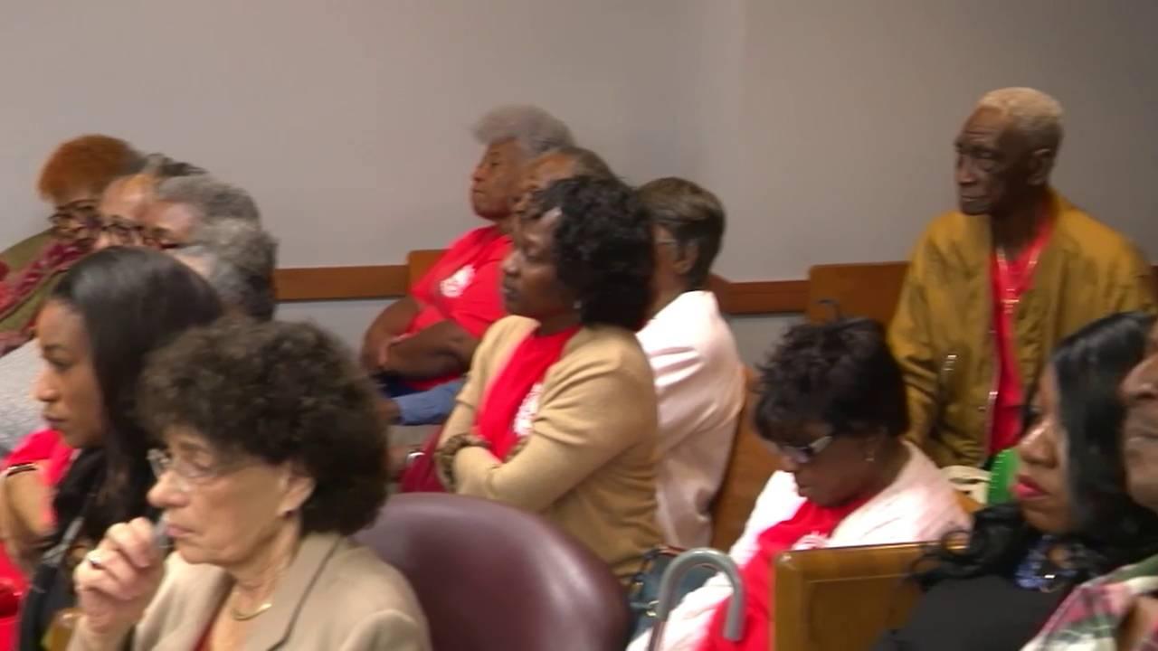 People in orange shirts at Mark Bartlett arraignment