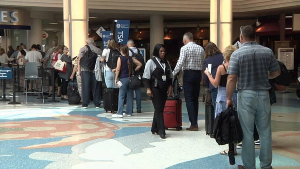 Travelers inside Jacksonville International Airport JIA JAX