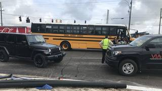 Witnesses: Truck runs red light, hits school bus in Yulee