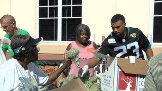 After big win, Jaguars give back to community