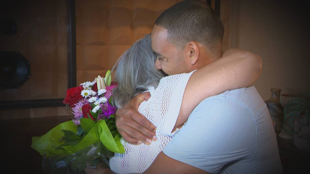 Eric Yutzy hugs his birth mother