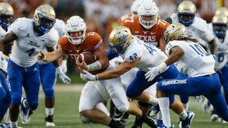 Ehlinger leads Texas to grinding win over Tulsa 28-21