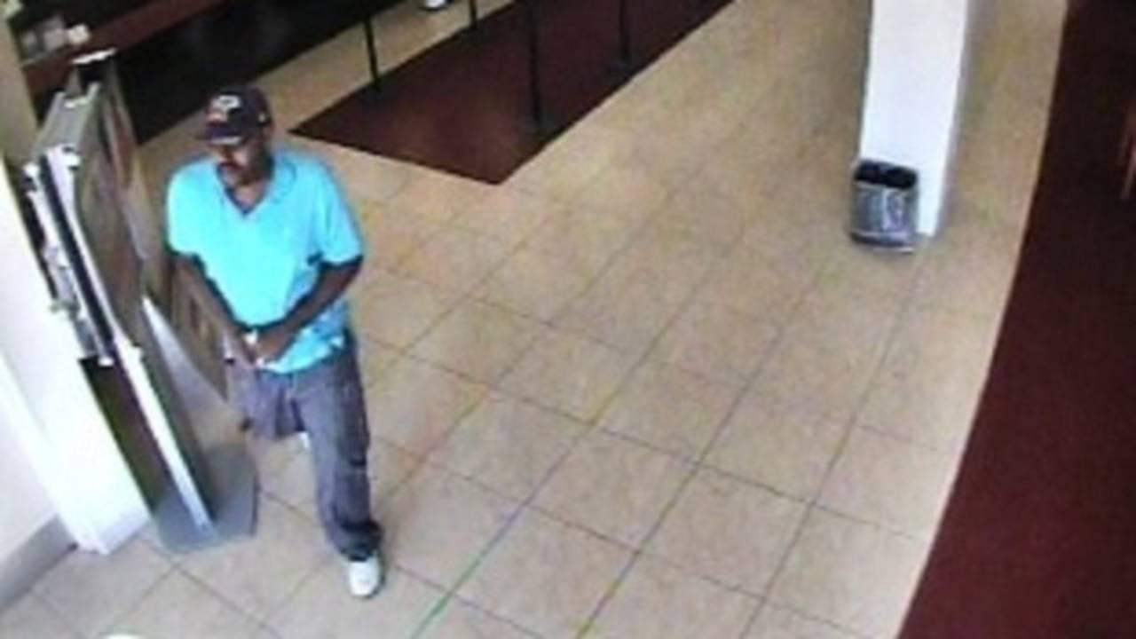 Robber leaving Tamarac bank with cash