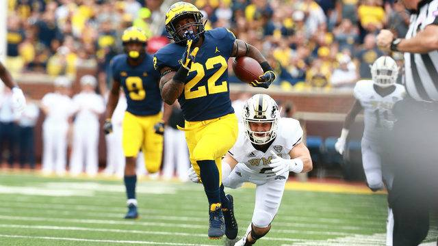 Karan Higdon  Of The Michigan Wolverines Runs The Ball To Score A First Quarter Touchdown Against The Against The Western Michigan Broncos At Michigan