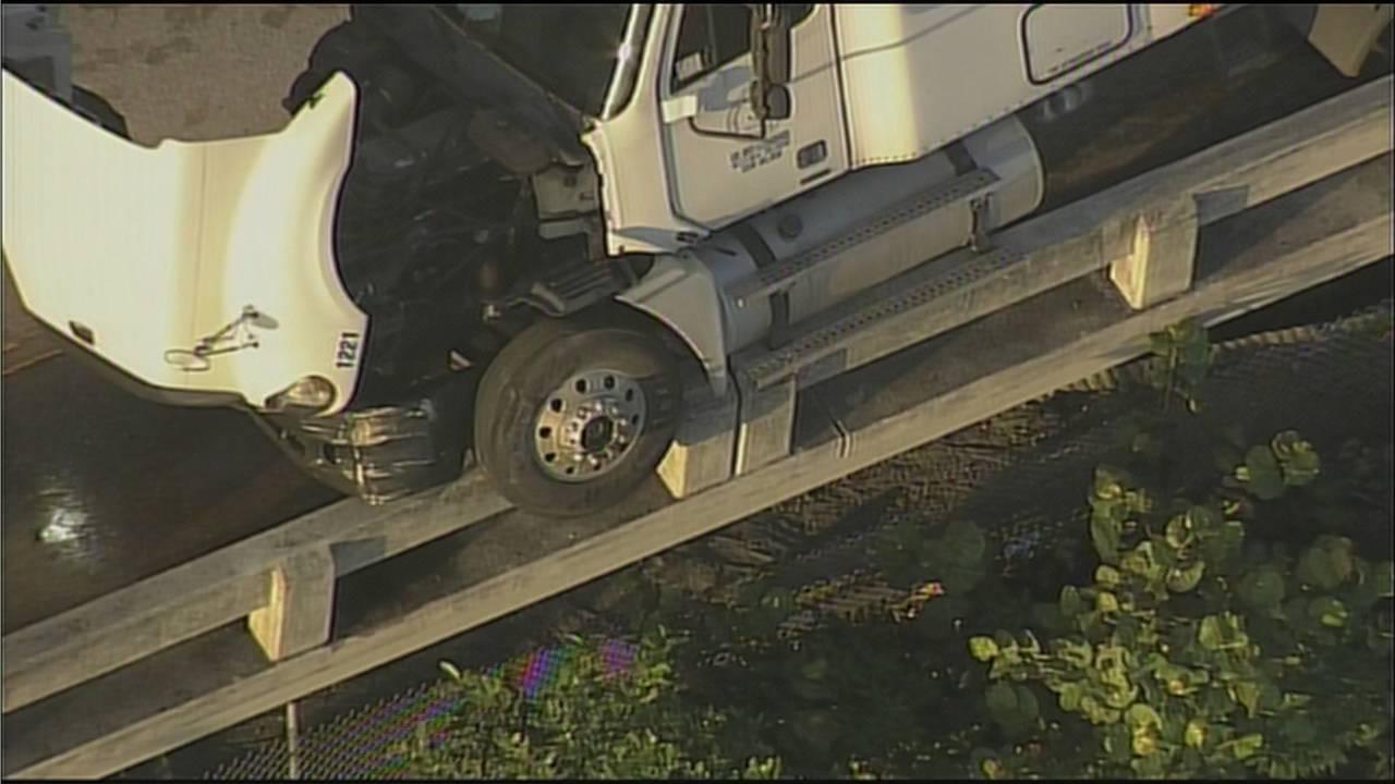 Truck hanging over I-395 ledge