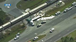 6 injured when train hits semi trailer stopped in crossing, FHP says