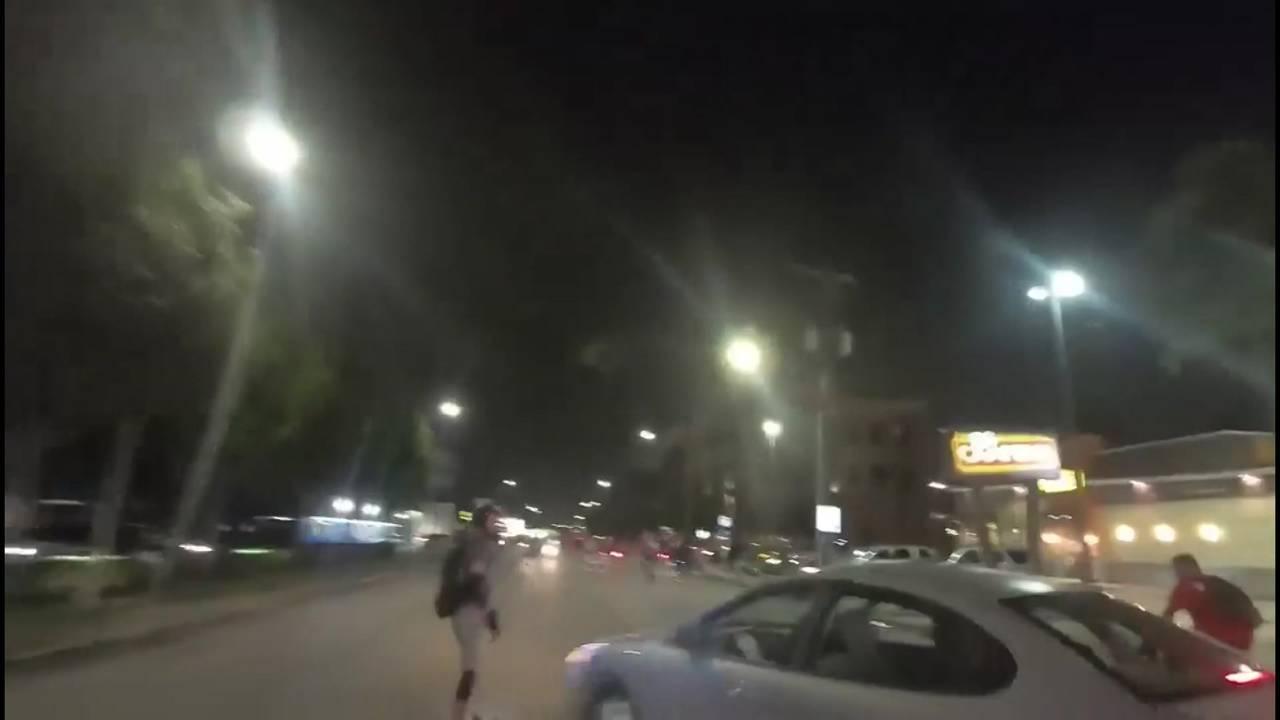 critical mass skateboarder hit by car
