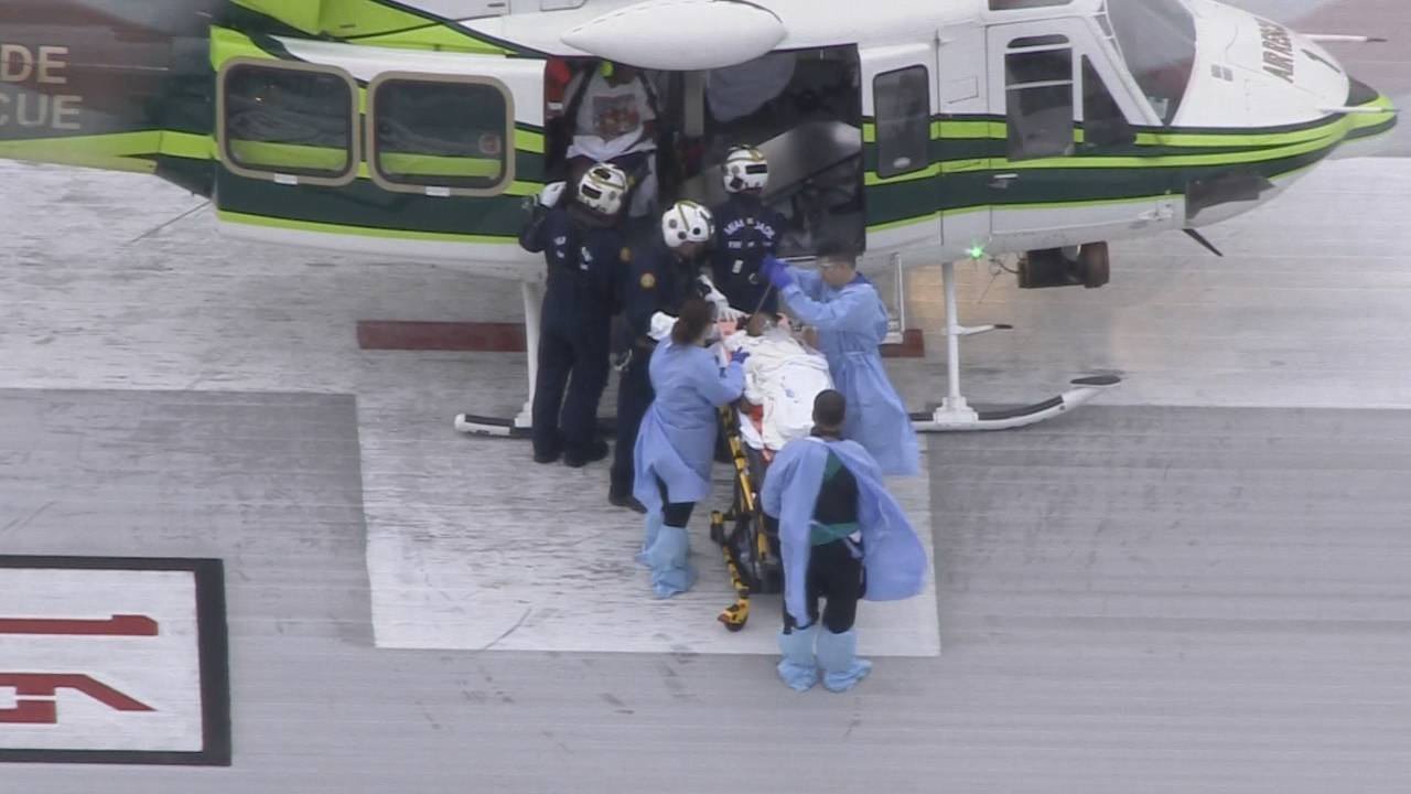 Florida City child being taken out of chopper at kendall regional
