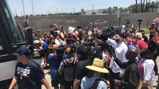 Protesters briefly block bus leaving migrant detention center in Texas