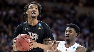 UCF defeats VCU 73-58, first win in school's history