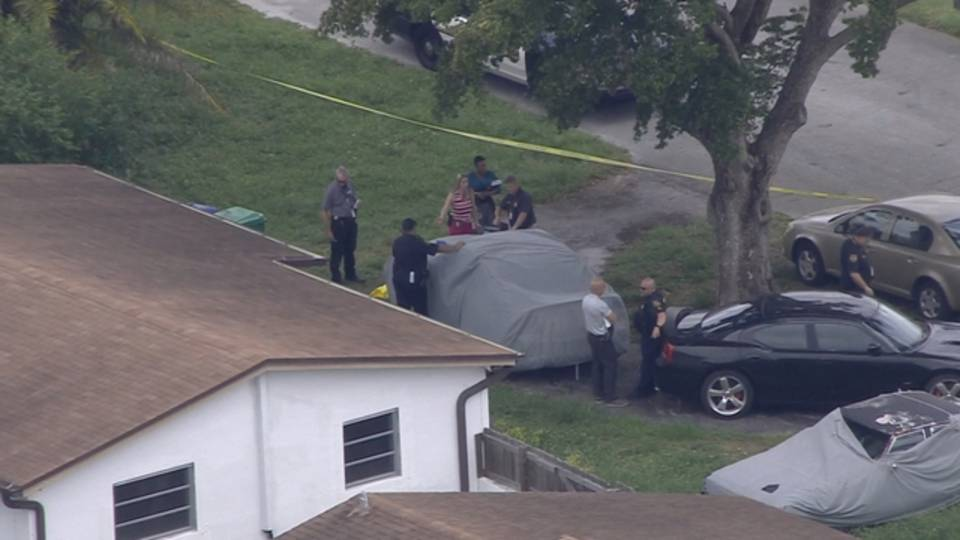Sky 10 Miramar police outside home of dog attack
