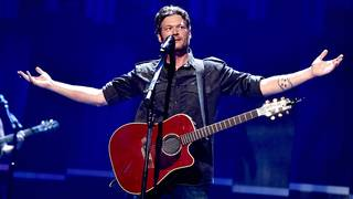 Blake Shelton took a spill on stage and asked fans for video of it