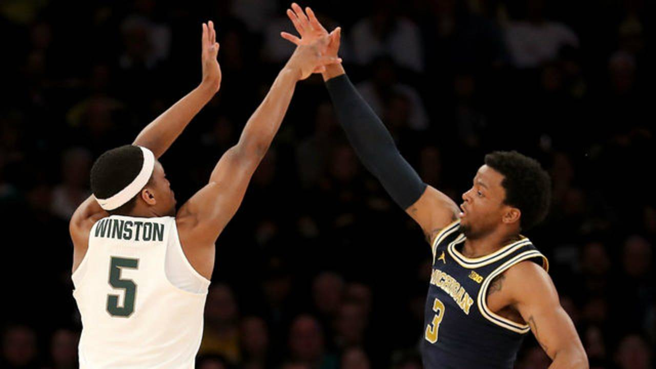Zavier Simpson and Cassius Winston Michigan basketball vs Michigan State 2018