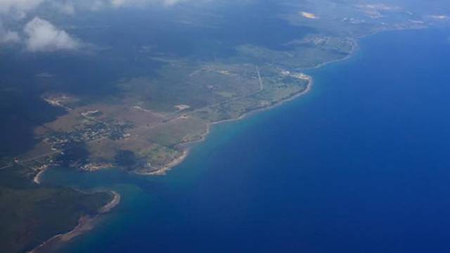 Giancarlo Sopo shot this photo of when his plane approached the island.