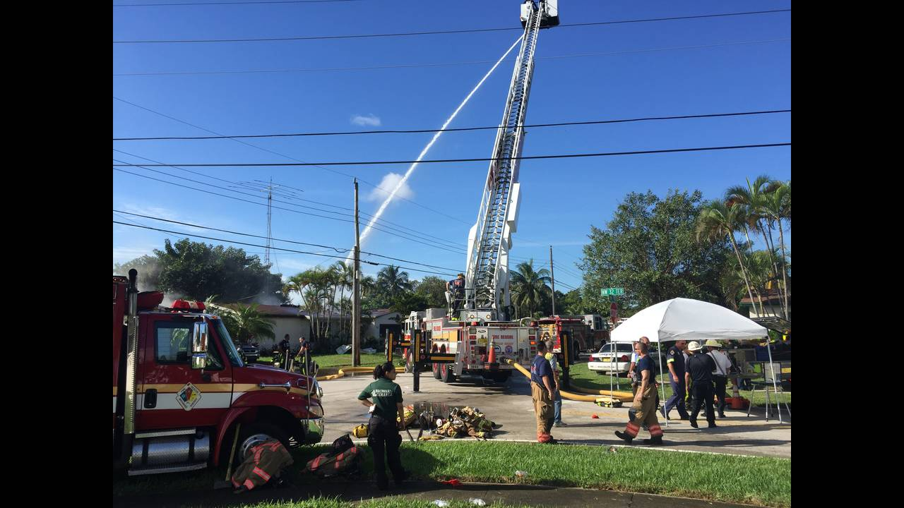 Firefighters dousing Lauderdale Lakes home