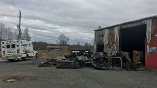 Crews fight 'fully involved' fire off of Route 220