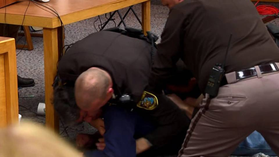 Father tackled after charging at Nassar