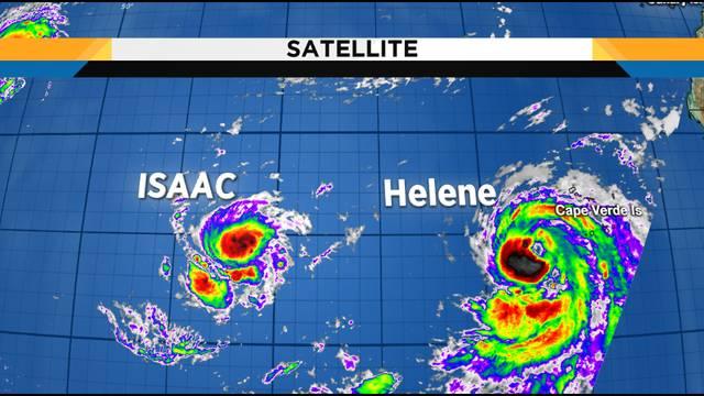 hurricane helene tropical storm isaac still churning through