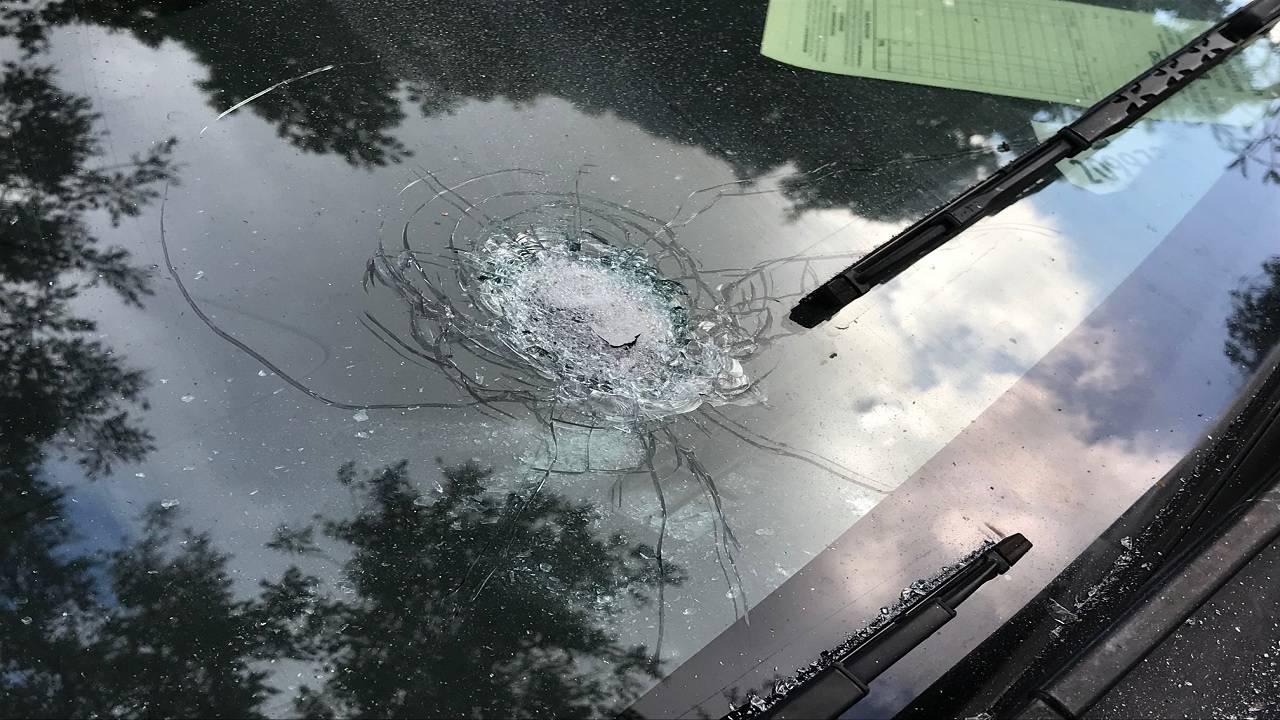 bullet hole in car window