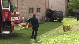 SUV crashes into apartment on East Side