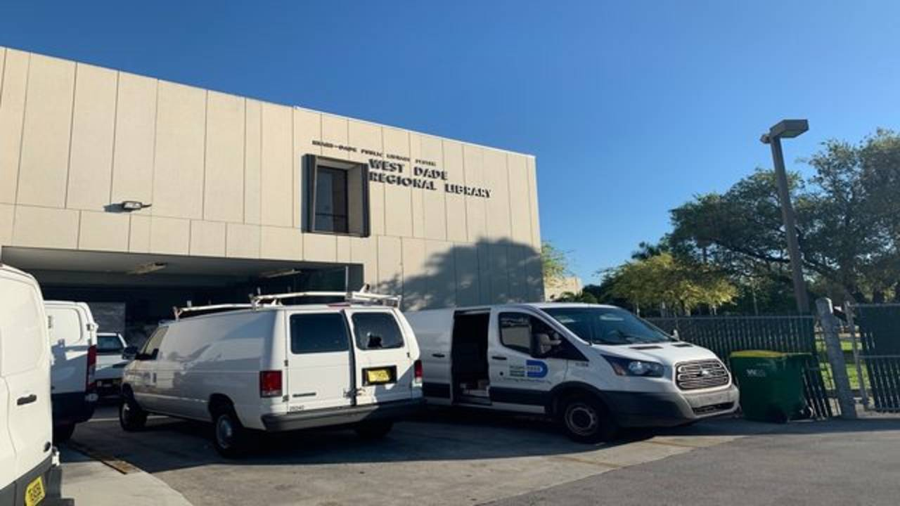 County vehicles outside West Dade Library