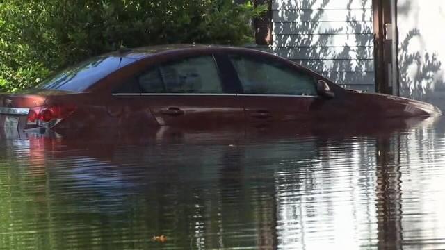 Vehicle in water_1527783755051.jpg.jpg