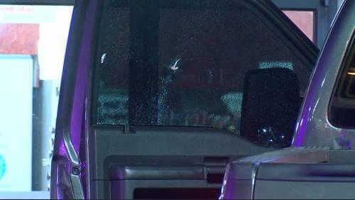 Man shoots at truck stopped at traffic light, hits driver, police say