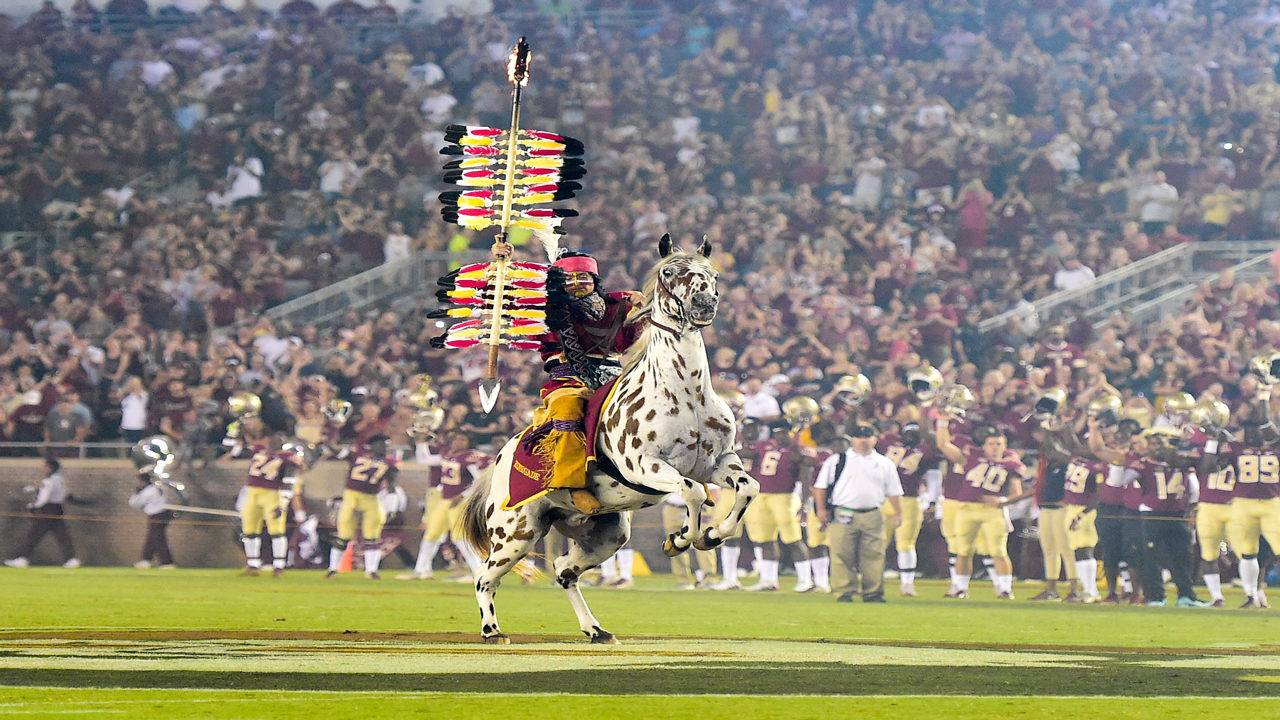 Florida State Seminoles Chief Osceola and Renegade planting spear at midfield in 2018