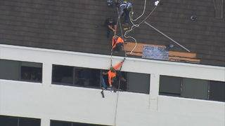 Roofer rescued from top of building after crashing into window in Kendall
