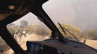 Water-Dropping Helicopter Rescues People and Dogs Trapped by California Flames