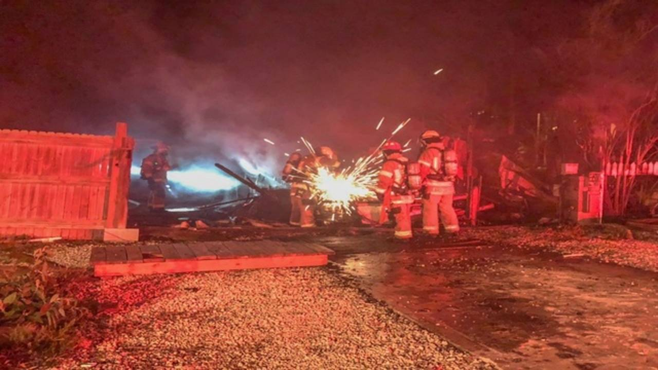Trailer Fire at Seahorse Campground -- working to lift wall